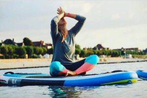 Yoga Unterricht auf dem SUP Board